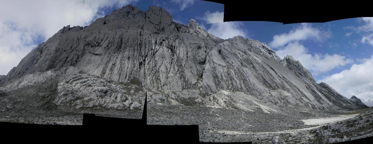 Panorama of Carstensz Pyramid north face (Robert Cassidy, 2010)